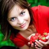 Sweet strawberry in hands Stock Photo