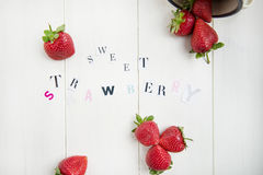 Sweet Strawberry Letters cut out from the Magazine Stock Image