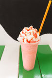 Sweet strawberry milkshake and frappe - iced and milk blended wi Stock Image