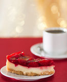 Sweet strawberry piece of cake and cup of tea Royalty Free Stock Images