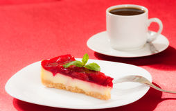 Sweet strawberry piece of cake and cup of tea Royalty Free Stock Photos