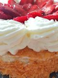 Sweet strawberry. Cake with white cream stock photography