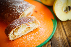Sweet strudel stuffed with quince Stock Photos