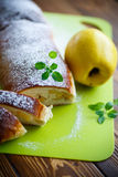 Sweet strudel stuffed with quince Stock Images