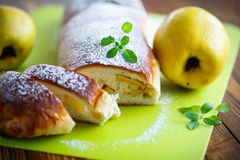 Sweet strudel stuffed with quince Royalty Free Stock Image