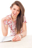 Sweet student girl chewing glasses Stock Image