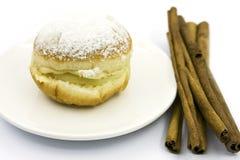 Sweet stuffed cinnamon donut Royalty Free Stock Image