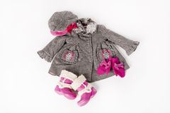 Sweet style for the little fashion girl. Coat into the pipette and pink wellington boots Stock Images