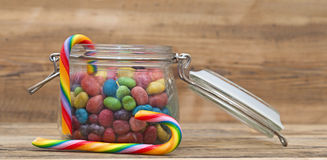 Sweet sugar candies in glass jars Royalty Free Stock Images