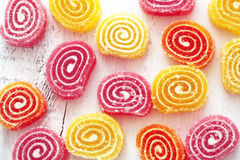 Candies. Sweet sugar candies on white wooden background Royalty Free Stock Photography