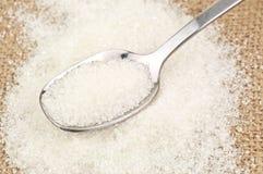 Sugar on spoon Stock Photos