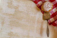 Sweet sugary donut on rustic red checkered napkin, vintage retro Royalty Free Stock Photo