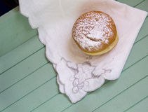 Sweet sugary donut on rustic wooden tray, top view of tasty bake Royalty Free Stock Image