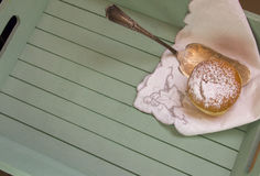 Sweet sugary donut on rustic wooden tray, top view of tasty bake Stock Photo