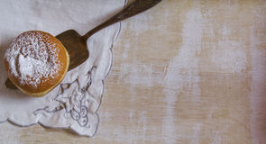Sweet sugary donut on vintage handmade napkin, retro overhead sh Stock Photography