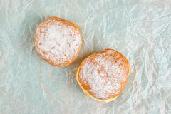 Sweet sugary donuts on baking paper Royalty Free Stock Image