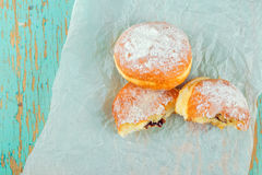 Sweet sugary donuts on rustic table Royalty Free Stock Photography