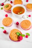 Sweet summer dessert, homemade baked muffin with raspberry jam, stock photography