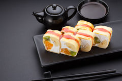 Sweet sushi roll in mamenori on a stone plate. Stock Photos