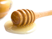 Sweet sweet honey. Honey spoon with honey on a white background Stock Photography