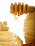 Sweet sweet honey. Honeypot with honeyspoon on a white background Stock Images