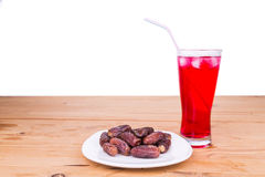 Sweet syrup, dates, simple iftar break fast food during Ramadan Royalty Free Stock Photos