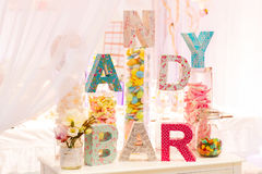 Sweet table as candy bar with different sweets on dinner or even. T party royalty free stock photo