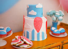 Sweet table with big cake, cupcakes, cake pops Stock Photo
