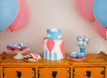 Sweet table with big cake, cupcakes, cake pops Stock Image