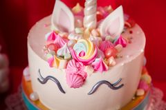 Sweet table and big unicorn cake for baby girl first birthday.  royalty free stock photography