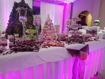 Sweet table, Bridal sweet cakes, a sweet table at the wedding, sweet buffet on a pink table in a party. A sweet table at weddings, heart-shaped cakes decorated Stock Photography