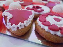 Sweet table, Bridal sweet cakes, a sweet table at the wedding. A sweet table at weddings, heart-shaped cakes decorated with red little hearts Royalty Free Stock Image