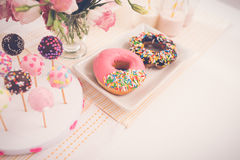 Sweet table. Cake pops and doughnuts on the sweet table stock photos