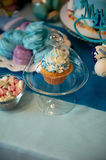 Sweet table for children`s birthday party in turquoise and purple. A sense of celebration,  joy. Beautiful sweets. Sweet table for children`s birthday party in Stock Image