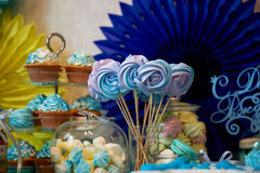 Sweet table for children`s birthday party in turquoise and purple. A sense of celebration,  joy. Beautiful sweets. Sweet table for children`s birthday party in Stock Photo