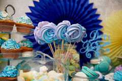 Sweet table for children`s birthday party in turquoise and purple. A sense of celebration,  joy. Beautiful sweets. Sweet table for children`s birthday party in Stock Photography