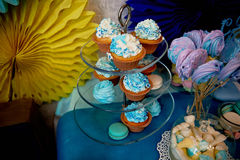 Sweet table for children`s birthday party in turquoise and purple. A sense of celebration,  joy. Beautiful sweets. Sweet table for children`s birthday party in Stock Images