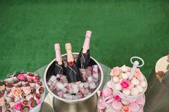 Sweet table with dessert and champagne Royalty Free Stock Images