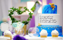Sweet table set with blue cake on wedding party Stock Images