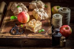 Sweet take away apple pie with crumble and icing. On old wooden table Royalty Free Stock Photography