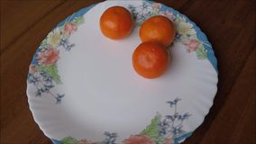 Sweet tangerines on plate stock video footage