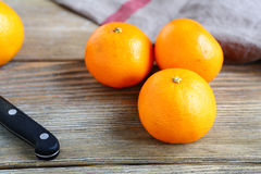 Sweet tangerines on a wooden boards Stock Photo