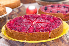Sweet tart with raspberries. Sweet tart with red  raspberries on a table Stock Image