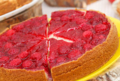 Sweet tart with red raspberries. On a table Stock Photo