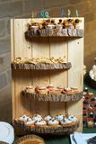Sweet tartlet snack with walnut and honey, close-up. Buffet catering food stock image
