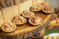Sweet tartlet snack with walnut and honey, close-up. Buffet catering food stock images
