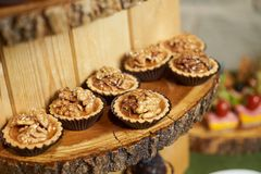 Sweet tartlet snack with walnut and honey, close-up. Buffet catering food royalty free stock photo