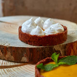 Sweet tartlets filled with cream Royalty Free Stock Image