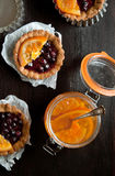 Sweet tartlets with jar of jam Stock Photo