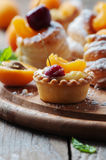 Sweet tarts with cherry and apricot Royalty Free Stock Image
